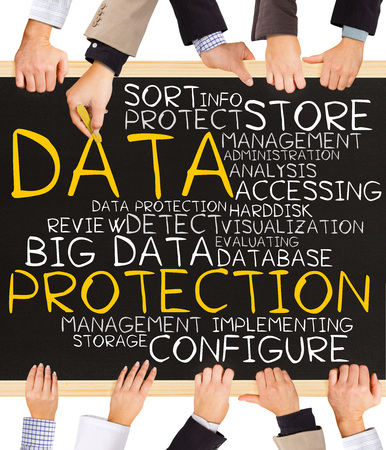 protection hands: Photo of business hands holding blackboard and writing DATA PROTECTION concept