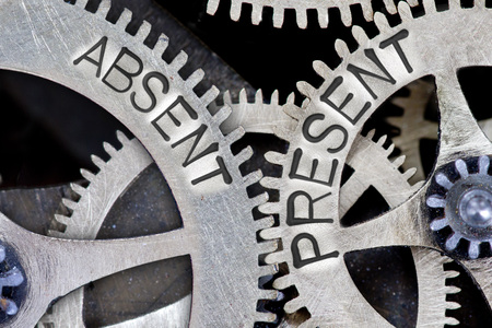 absent: Macro photo of tooth wheel mechanism with ABSENT PRESENT concept words Stock Photo