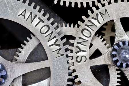 synonym: Macro photo of tooth wheel mechanism with ANTONYM, SYNONYM concept words