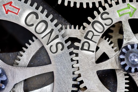 cons: Macro photo of tooth wheel mechanism with arrows and CONS, PROS concept words Stock Photo
