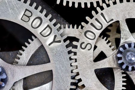 body and soul: Macro photo of tooth wheel mechanism with BODY, SOUL concept words Stock Photo