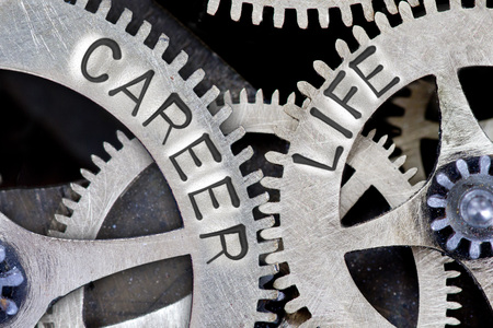 career life: Macro photo of tooth wheel mechanism with CAREER, LIFE concept words