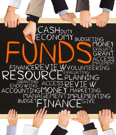 fondos negocios: Photo of business hands holding blackboard and writing FUNDS concept Foto de archivo