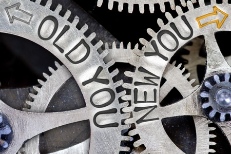 imprinted: Macro photo of tooth wheel mechanism with imprinted arrows and OLD YOU, NEW YOU concept words Stock Photo