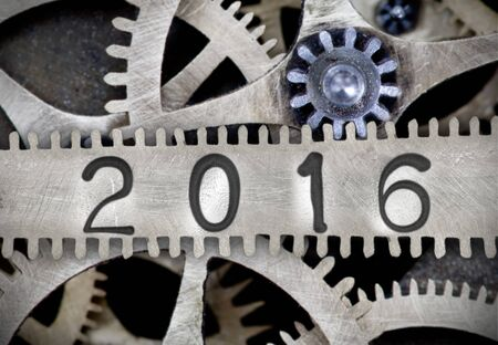 imprinted: Macro photo of tooth wheel mechanism with number 2016 imprinted on clean metal surface; New Year concept Stock Photo