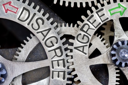 agree: Macro photo of tooth wheel mechanism with imprinted arrows and DISAGREE, AGREE concept words Stock Photo