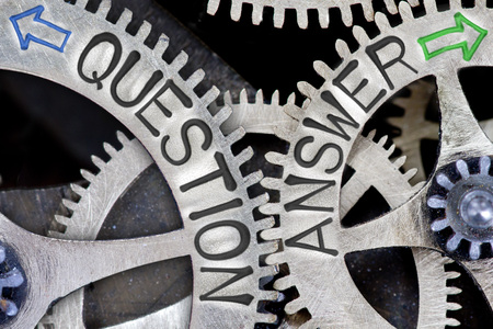 imprinted: Macro photo of tooth wheel mechanism with imprinted arrows and QUESTION, ANSWER concept words Stock Photo