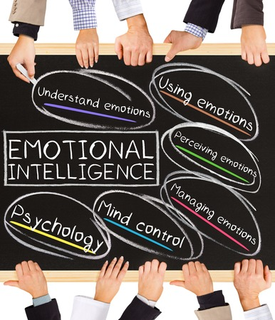 improved: Photo of business hands holding blackboard and writing EMOTIONAL INTELLIGENCE concept