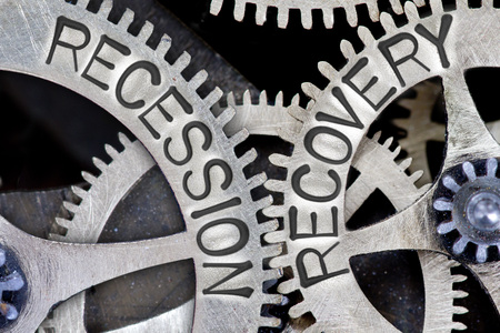 imprinted: Macro photo of tooth wheel mechanism with imprinted RECESSION, RECOVERY concept words Stock Photo