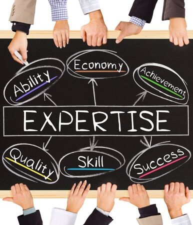 expertise concept: Photo of business hands holding blackboard and writing EXPERTISE concept