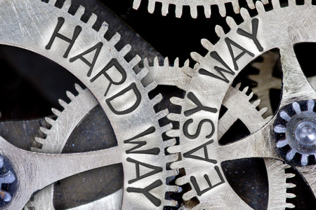 imprinted: Macro photo of tooth wheel mechanism with imprinted HARD WAY, EASY WAY concept words Stock Photo