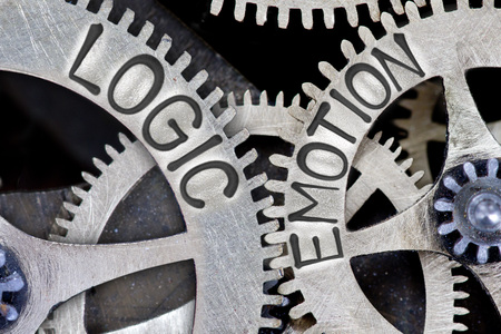 imprinted: Macro photo of tooth wheel mechanism with imprinted LOGIC, EMOTION concept words Stock Photo