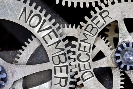 imprinted: Macro photo of tooth wheel mechanism with imprinted NOVEMBER, DECEMBER concept words