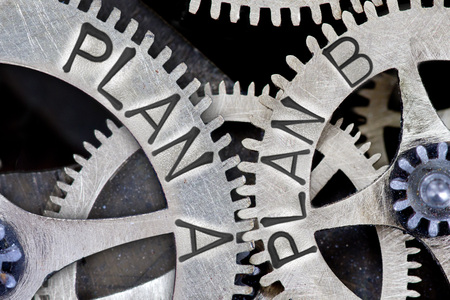 imprinted: Macro photo of tooth wheel mechanism with imprinted PLAN A, PLAN B concept words Stock Photo