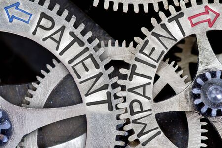 imprinted: Macro photo of tooth wheel mechanism with imprinted arrows and PATIENT, IMPATIENT concept words Stock Photo
