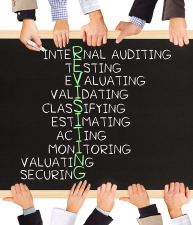 validating: Photo of business hands holding blackboard and writing REVISITING concept