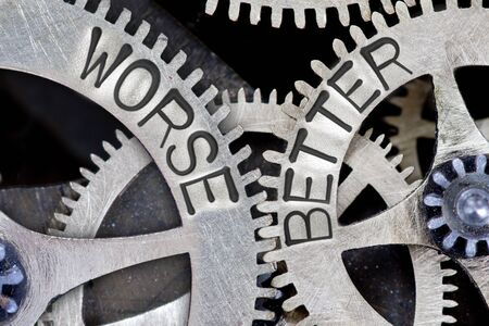 worse: Macro photo of tooth wheel mechanism with imprinted WORSE, BETTER concept words