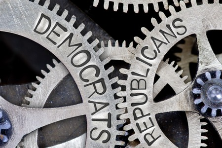 imprinted: Macro photo of tooth wheel mechanism with imprinted DEMOCRATS, REPUBLICANS concept words Stock Photo