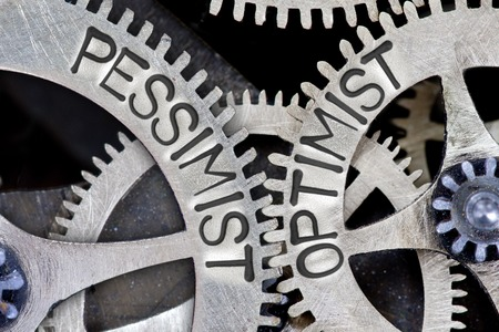 pessimist: Macro photo of tooth wheel mechanism with imprinted PESSIMIST, OPTIMIST concept words Stock Photo