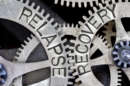 Macro photo of tooth wheel mechanism with imprinted RELAPSE, RECOVERY concept words Stock Photo - 70386167