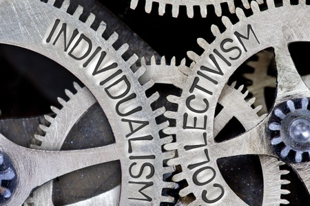 individualism: Macro photo of tooth wheel mechanism with imprinted INDIVIDUALISM, COLLECTIVISM concept words Stock Photo
