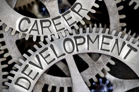career development: Macro photo of tooth wheel mechanism with CAREER DEVELOPMENT concept letters