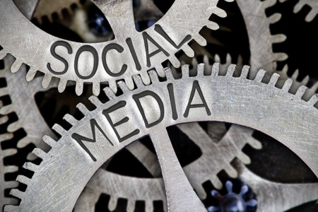 Macro photo of tooth wheel mechanism with SOCIAL MEDIA letters imprinted on metal surface Stok Fotoğraf