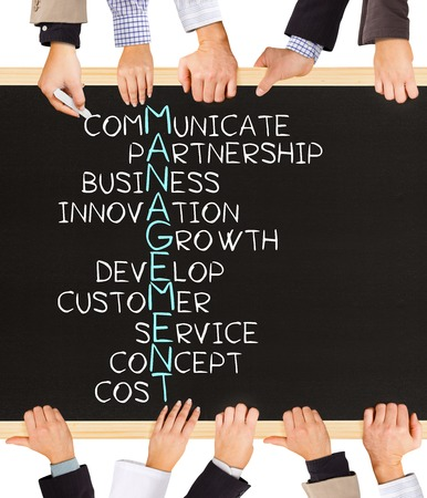 Photo of business hands holding blackboard and writing MANAGEMENT concept Stock Photo
