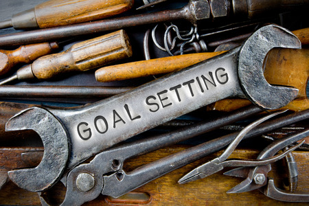 vision repair: Photo of various tools and instruments with GOAL SETTING letters imprinted on a clear wrench surface Stock Photo