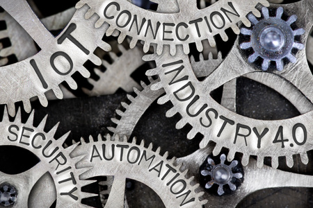 Macro photo of tooth wheels with INDUSTRY 4.0, IoT, CONNECTION, AUTOMATION and SECURITY words imprinted on metal surface Foto de archivo