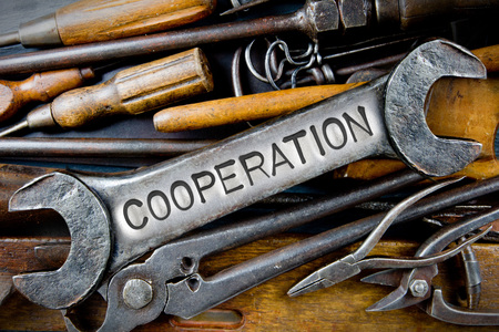 vision repair: Photo of various tools and instruments with COOPERATION letters imprinted on a clear wrench surface
