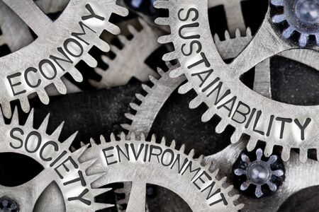 Macro photo of tooth wheel mechanism with SUSTAINABILITY, ECONOMY, SOCIETY and ENVIRONMENT words imprinted on metal surface Reklamní fotografie