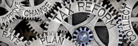 金属面に刻印される税制改革や収集、変更計画、速度向上の言葉で歯輪機構のマクロ写真 写真素材