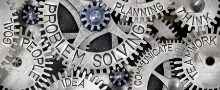 Macro photo of tooth wheel mechanism with PROBLEM SOLVING concept related words imprinted on metal surface Stock Photo