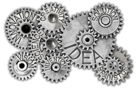 Macro photo of tooth wheel mechanism with IDEA concept related words and icons imprinted on metal surface isolated on white Stok Fotoğraf
