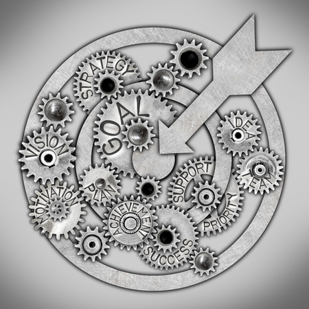 Target and tooth wheel mechanism with GOAL concept related words imprinted on metal surface