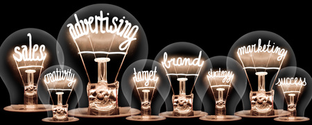 Photo of light bulbs with shining fibres in shapes  concept related words isolated on black background