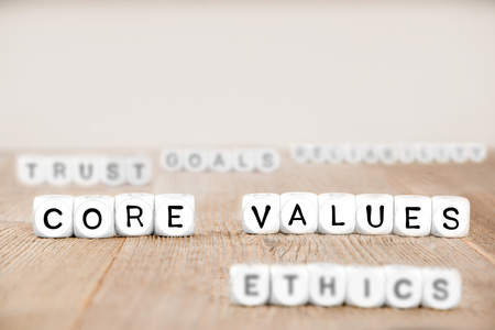 White cube blocks with Core Values, Ethics, Trust and Goals words imprinted on cube surface