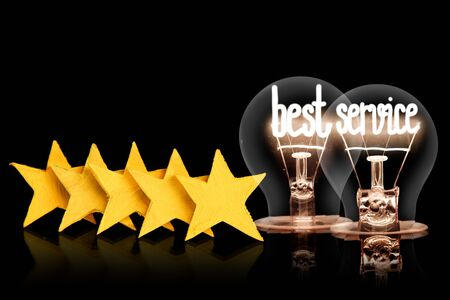 Photo of five yellow stars and light bulbs with shining fibers in a shape of Best Service concept words isolated on black background.