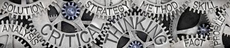 Group of tooth wheel mechanism with Critical Thinking, Strategy, Skill, Solution and Fact words imprinted on metal surface. Banque d'images