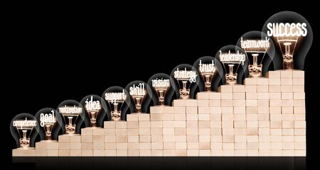 Light bulbs with shining fibers in a shape of Success, Teamwork, Support and Trust concept related words on wooden block ladder isolated on black background. Zdjęcie Seryjne