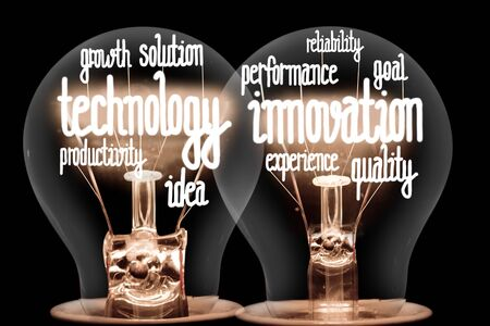 Group of light bulbs on coin stacks with shining fibers in a shape of Technology Innovation, Growth, Goal, Reliability and Idea concept related words isolated on black background