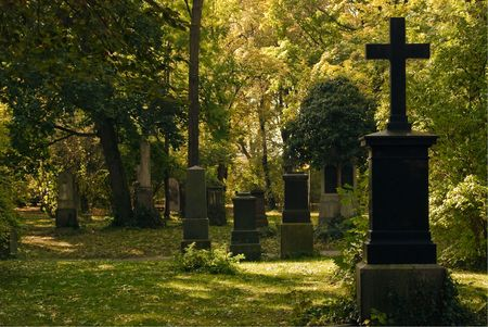 grave site: Cemetery  Image with Crosses in a Wooded Area Stock Photo