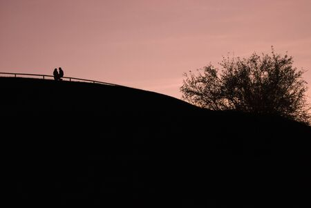 Silhouette of a Couple on a Hill Stock Photo - 3767211