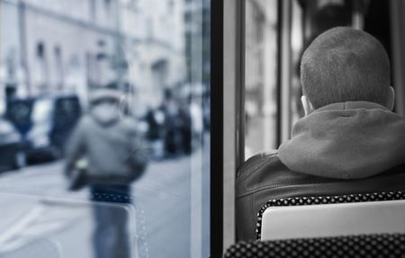 Artistic Image of a Young Man on a Bus Stock Photo