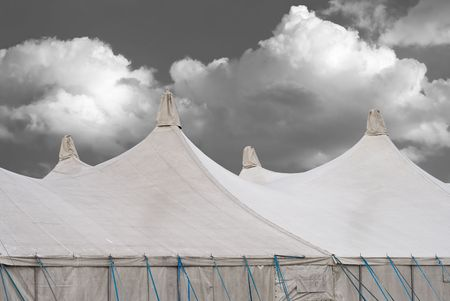 marquee tent: Circus Tents on a Fairground with Cumulus Clouds