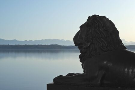 Lion Statue with German Alps and Lake Stock Photo - 5969124