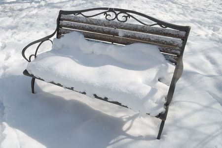 Lonely Bench after a Snowstorm photo