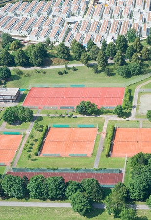 Aerial View with Tennis Courts and Residential Housing photo