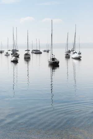 Moored Sailboats on a Calm Bavarian Lake Stock Photo